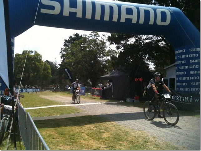Crossing the finishing line after 6 hours and 35 minutes of riding